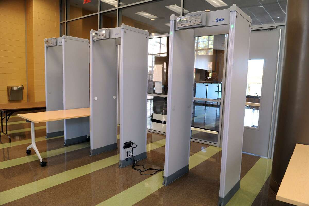 Students at Fairchild Wheeler Interdistrict Magnet School Campus pass through these metal detectors when they arrive for school, seen here Oct. 27, 2014, in Bridgeport, Conn.