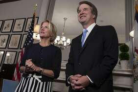 Judge Brett Kavanaugh (right) with Sen. Shelley Moore Capito, R-W.V., before meeting more senators.