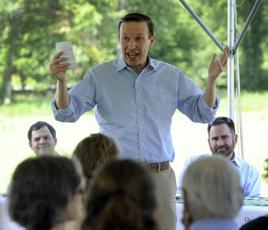 U.S. Sen. Chris Murphy speaks Friday at a gathering to celebrate the Highlands Conservation Act. Left is Tim Abbott, Regional Land Conservation director and right is Robert Klee, DEEP commissioner for the state. Several conservation groups are hosted U.S. Sen. Chris Murphy in Kent Friday, July 13, 2018, to celebrate the Highlands Conservation Act, which is one of the most important sources of federal land protection funding in Northwest Connecticut. Photo: Carol Kaliff / Hearst Connecticut Media / The News-Times