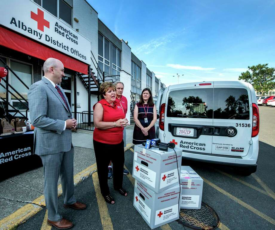 Paula Stopera, president and CEO of CAP COM, second from left, announces the donation to the American Red Cross, a new blood transport vehicle to its fleet based locally thanks to a donation from CAP COM Federal Credit Union Friday  July 13, 2018 in Albany, N.Y. (Skip Dickstein/Times Union) Photo: SKIP DICKSTEIN / 20044318A