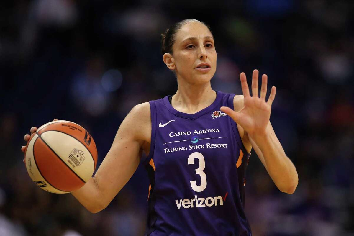 PHOENIX, AZ - JULY 05: Diana Taurasi #3 of the Phoenix Mercury handles the ball during the first half of WNBA game against the Connecticut Sun at Talking Stick Resort Arena on July 5, 2018 in Phoenix, Arizona. NOTE TO USER: User expressly acknowledges and agrees that, by downloading and or using this photograph, User is consenting to the terms and conditions of the Getty Images License Agreement. (Photo by Christian Petersen/Getty Images)