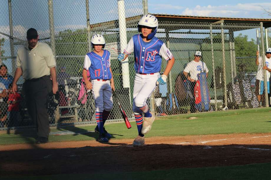 Cole Neatherlin scores a run for the Northern League 9-11 year old all-stars, as Jaden Rogers holds a bat in the background. Photo: Janice Hernandez / Courtesy Photo