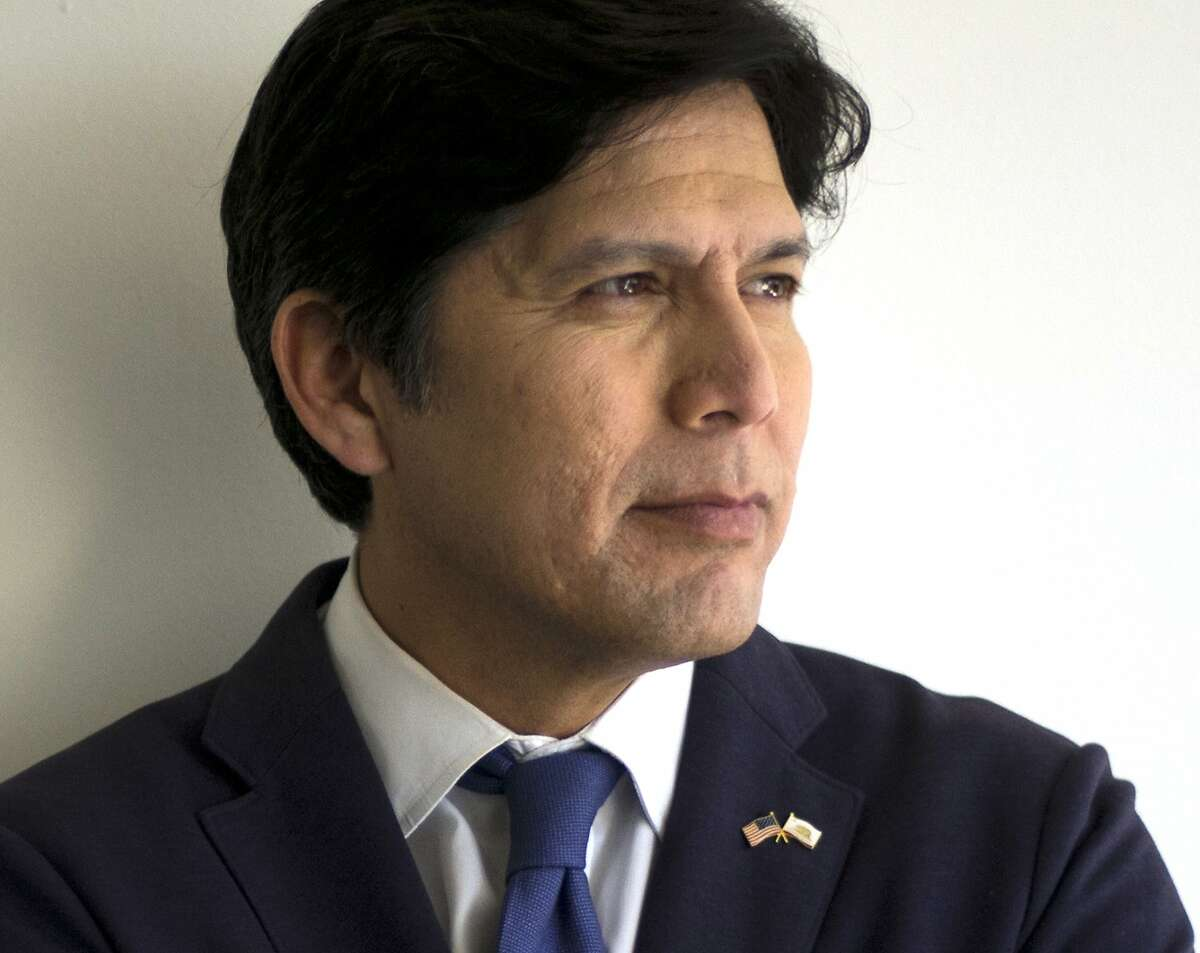 FILE - In this May 3, 2018 file photo, California state Senate President pro Tempore Kevin de Leon, D-Los Angeles, poses for photos in his campaign office in Los Angeles. U.S. Sen. Feinstein is tapping into her political rolodex to convince California Democratic Party leaders to not formally endorse a candidate in her race against fellow Democrat Kevin de Leon. She says it's to avoid an intraparty fight, but her effort if successful will thwart her longshot rival's very real change at capturing the party nod when the committee votes Saturday, July 14, 2018. (AP Photo/Jae C. Hong, File)