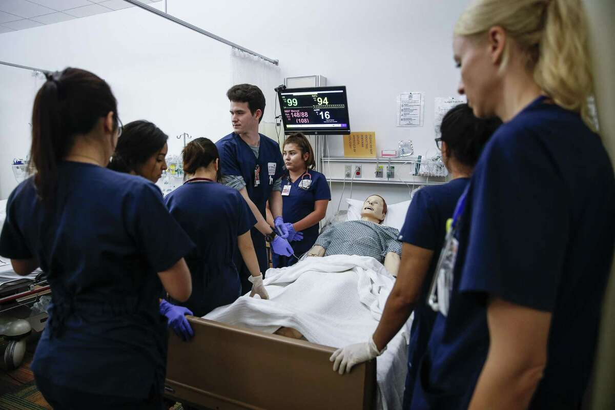 UT Health School of Nursing students work through a simulation with a mannequin experiencing a pulmonary embolism July 13, 2018 in Houston. Even though male nurses make up between 10 and 12 percent of the overall nursing population in the United States, a new study contends that male nurses, on average across disciplines, make about $6,600 more annually than women doing the same job.