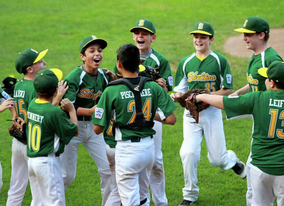Shelton celebrates its win over Union City in District 3 little league baseball action in Naugatuck on Friday. Photo: Christian Abraham / Hearst Connecticut Media / Connecticut Post
