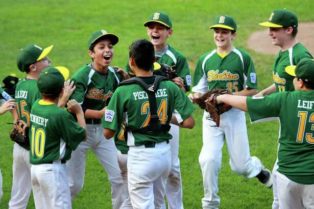 Shelton celebrates its win over Union City in District 3 little league baseball action in Naugatuck on Friday.