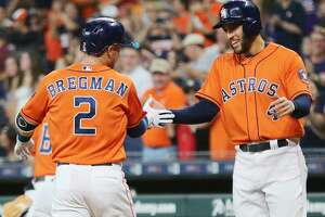 Houston Astros third baseman Alex Bregman (2) is congratulated by Houston Astros designated hitter George Springer (4) after his two-run home run that brought them both in to make the score 2-0 in the bottom of the first inning against Detroit Tigers at Minute Maid Park on Friday, July 13, 2018 in Houston.  (Elizabeth Conley/Houston Chronicle)