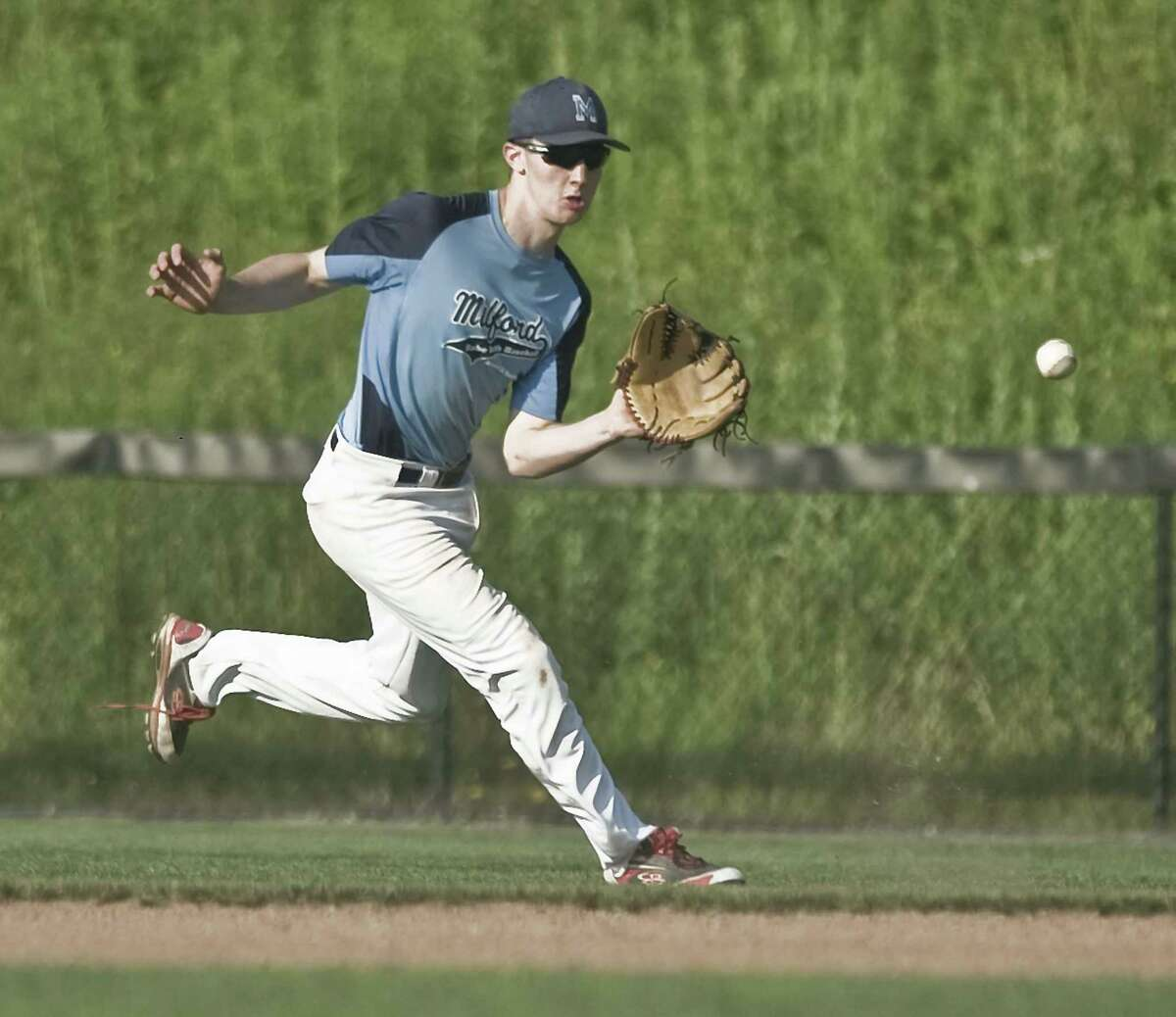 Milford right fielder Joseph Gaetano fields the ball on a hop in game 2 of the 13-year-old Babe Ruth baseball state tournament championship against New Milford, played at the Fairfield Hills Complex in Newtown. Friday, July 13, 2018