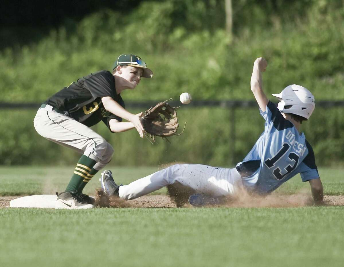 New Milford second baseman Jacob Gee tries to get Milford's Cody Dineson in game 2 of the 13-year-old Babe Ruth baseball state tournament championship played at the Fairfield Hills Complex in Newtown. Friday, July 13, 2018