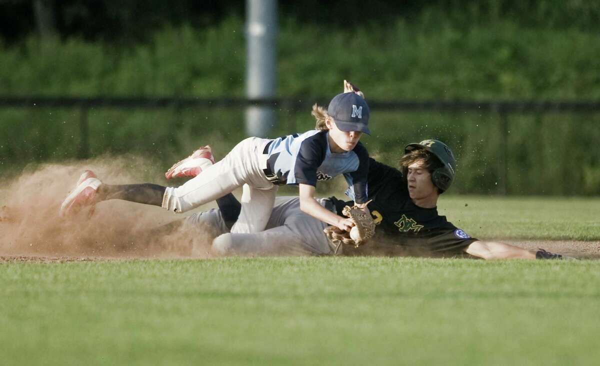 Milford second baseman Jack D'Avignon is upended by New Milford's Kyle Murphy in game 2 of the 13-year-old Babe Ruth baseball state tournament championship played at the Fairfield Hills Complex in Newtown. Friday, July 13, 2018