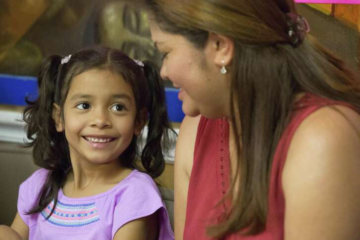 Allison Ximena Valencia Madrid, 6, stares at her mother Cindy Madrid happily to be with her again, Friday, July 13, 2018, in Houston. Allison was one of the children who was separated from their parent at the US-Mexico border during the Trump administration's zero-tolerance policy on illegal border crossings. Mother and daughter were reunited in Houston, Friday morning. ( Marie D. De Jesús / Houston Chronicle )