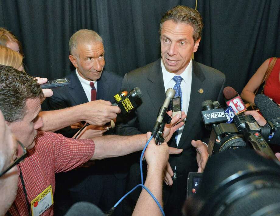 Gov. Andrew Cuomo, right, and Albany Nanocollege CEO Alain Kaloyeros  speak with reporters following  the announcement of  a new $500 million power electronics manufacturing consortium in the Capital Region at GE Global Research Tuesday July 15, 2014, in Niskayuna, NY.  (John Carl D'Annibale / Times Union) Photo: John Carl D'Annibale / 00027804A