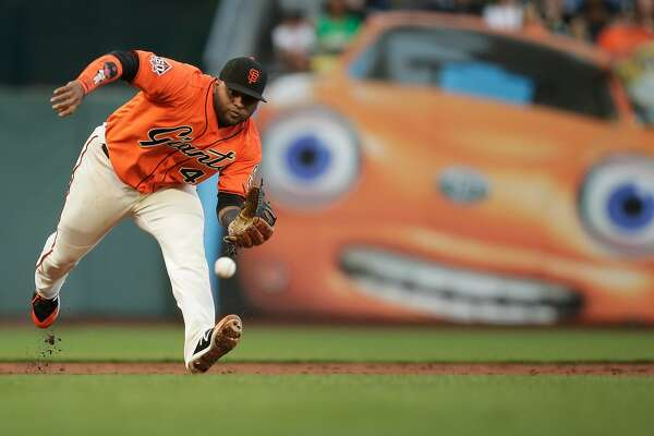San Francisco Giants third baseman Pablo Sandoval (48) grabs the ground ball and throws to first base for the out during the top of the second inning of an MLB game between the San Francisco Giants and Oakland Athletics at AT&T Park on Friday, July 13, 2018, in San Francisco, Calif.
