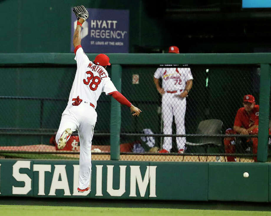 A double by the Reds' Eugenio Suarez goes over the head of Cardinals right fielder Jose Martinez in the fifth inning of Friday night's game in St. Louis. Photo:       Jeff Roberson | AP Photo