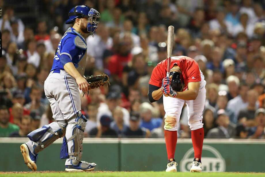 BOSTON, MA - JULY 13:  Russell Martin #55 of the Toronto Blue Jays looks on as Mookie Betts #50 of the Boston Red Sox reacts after striking out in the fifth inning of a game at Fenway Park on July 13, 2018 in Boston, Massachusetts.  (Photo by Adam Glanzman/Getty Images) Photo: Adam Glanzman / 2018 Getty Images