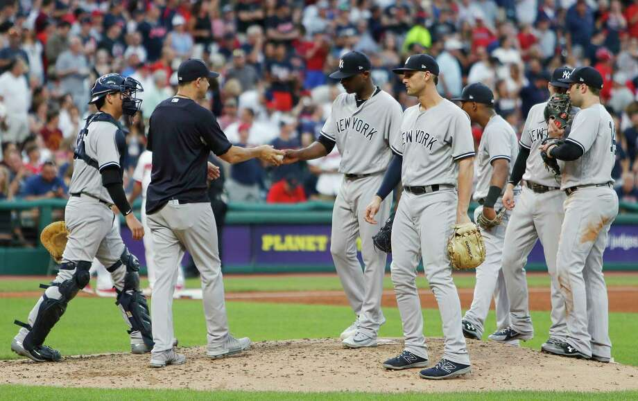 CLEVELAND, OH - JULY 13:   New York Yankees Manager Aaron Boone #17 removes starting pitcher Domingo German #65 from the game during the fifth inning against the Cleveland Indians at Progressive Field on July 13, 2018 in Cleveland, Ohio. (Photo by David Maxwell/Getty Images) Photo: David Maxwell / 2018 Getty Images