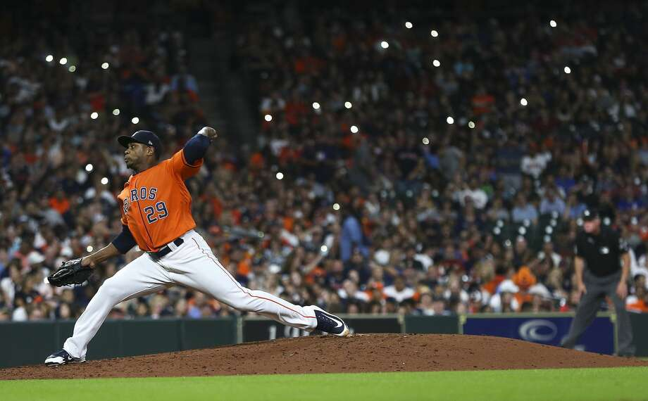 Houston Astros fans shine their cell phone lights as Houston Astros relief pitcher Tony Sipp (29) pitches in the seventh inning against  the Detroit Tigers at Minute Maid Park on Friday, July 13, 2018 in Houston.  (Elizabeth Conley/Houston Chronicle) Photo: Elizabeth Conley/Houston Chronicle