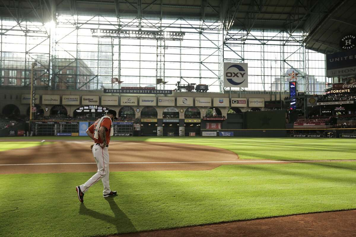 Houston Astros starting pitcher Dallas Keuchel (60) walks onto the field to warm up before Friday's game against the Detroit Tigers at Minute Maid Park on Friday, July 13, 2018 in Houston. (Elizabeth Conley/Houston Chronicle)