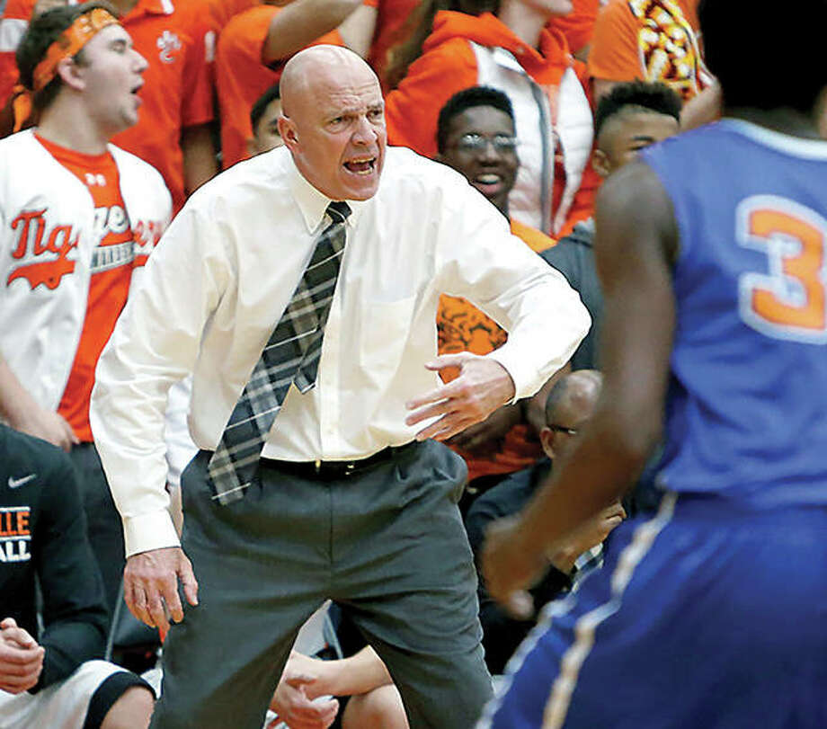 Edwardsville coach Mike Waldo ends his 30-year run at Edwardsville as the 2018 Telegraph Large-Schools Boys Basketball coach of the Year after guiding the Tigers to an 18-9 record and a runner-up finish in the SWC. Photo:       Telegraph File Photo