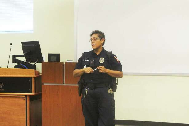 Officer Elizabeth Garcia, of the Lone Star College Police Department, explains during an active shooter presentation on Thursday, July 12, 2018, that something as simple as a pencil, like the one she is holding, can be used as a makeshift weapon to protect against an active shooter if the options of running and hiding are not feasible.