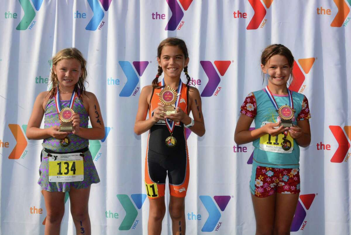 """The in-person 2020 YMCA Kids Triathlon, a popular short-course event for children ages 5 years old to 15 who are just learning the sport, has been canceled and will instead be conducted in a """"virtual"""" manner, with kids doing the events alone with a parent or coach timing their effort. Registration ends Oct. 21."""