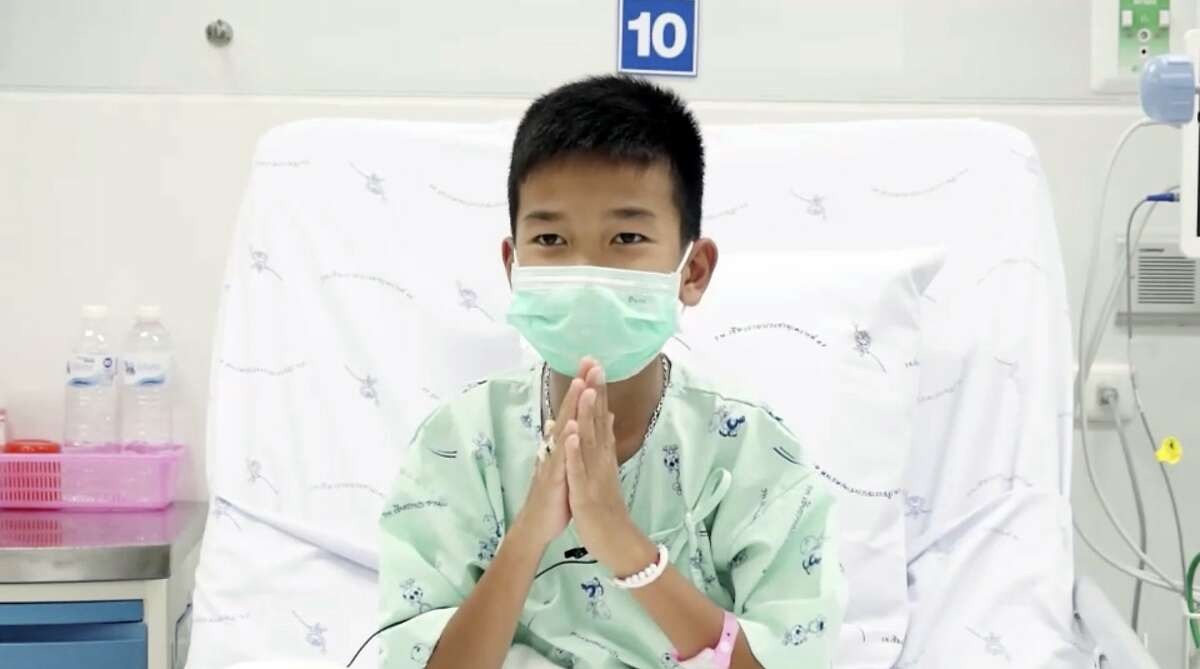 This image made from a video taken on July 13, 2018 and released by Chiang Rai Prachanukroh Hospital, shows Chanin Vibulrungruang, one of the 12 boys rescued from the flooded cave, in their hospital room at Chiang Rai Prachanukroh Hospital in Chiang Rai province, northern Thailand. The video was shown during a press conference at the hospital Saturday, July 14, 2018. (Chiang Rai Prachanukroh Hospital via AP)