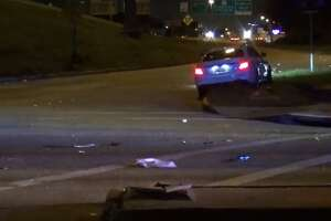 Houston Police are trying to locate a man who they say ran over his passenger after an accident in north Houston. The suspect was driving black truck when he ran a red light the crashed with another car on the I-610 N. service road near Airline Drive around 2 a.m., HPD said. His passenger fell out of the car as it hit a nearby light pole, HPD said, after which the driver tried to reverse and hit the woman, breaking multiple of her bones.