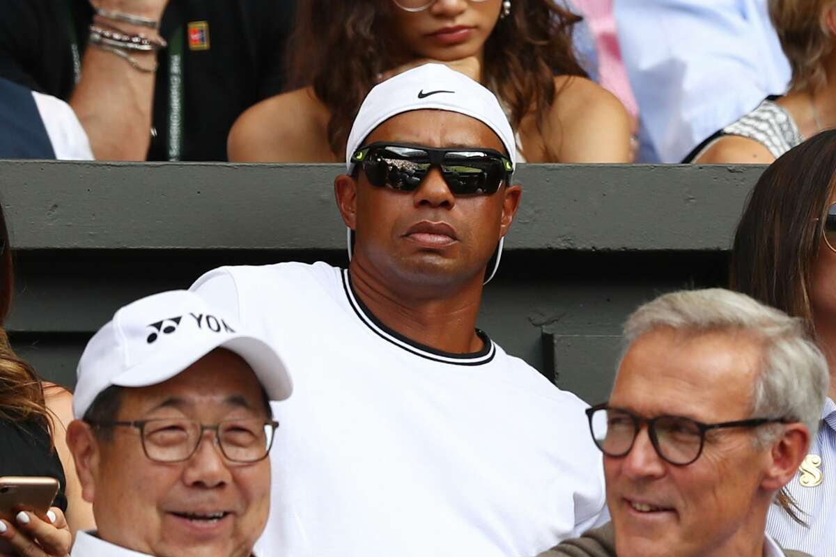 LONDON, ENGLAND - JULY 14: Tiger Woods watches the Ladies' Singles final on day twelve of the Wimbledon Lawn Tennis Championships at All England Lawn Tennis and Croquet Club on July 14, 2018 in London, England. (Photo by Michael Steele/Getty Images)