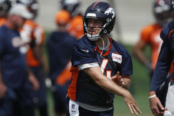 Denver Broncos quarterback Case Keenum (4) takes part in drills at the NFL football team's training camp Thursday, June 14, 2018, in Englewood, Colo. (AP Photo/David Zalubowski)