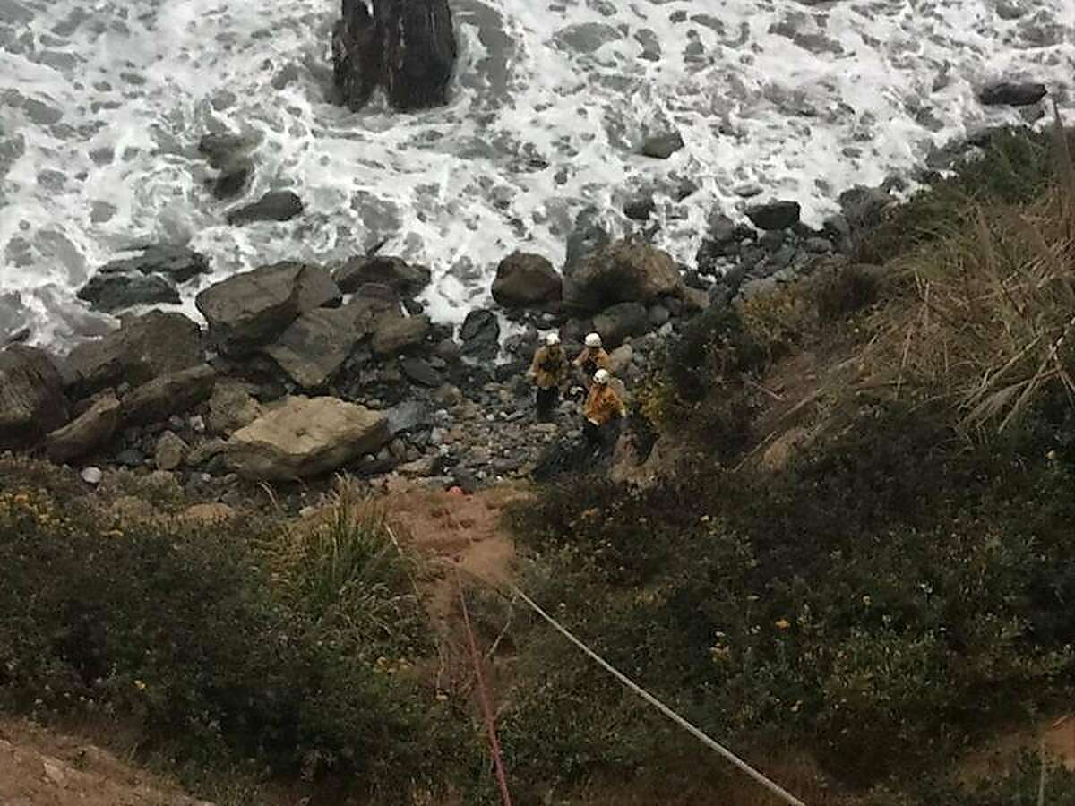 Rescue crews tend to Angela Hernandez at the bottom of a Monterey County cliff. Hernandez went missing on July 6 while driving from Portland to visit her sister in Southern California.