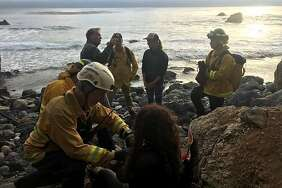 Rescue crews tend to Angela Hernandez at the bottom of a Monterey County cliff, where she had been for seven days.