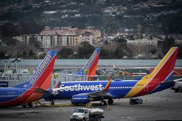 Southwest Airlines Co. planes stand on the tarmac at San Francisco International Airport (SFO) in San Francisco, California, U.S., on Friday, Jan. 19, 2018. Southwest Airlines Co. is scheduled to release earnings on January 25. Photographer: David Paul Morris/Bloomberg