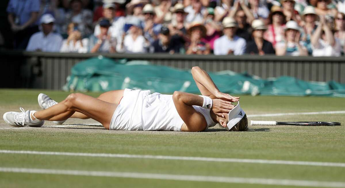 Germany's Angelique Kerber celebrates after winning against US player Serena Williams during their women's singles final match on the twelfth day of the 2018 Wimbledon Championships at The All England Lawn Tennis Club in Wimbledon, southwest London, on July 14, 2018. Kerber won the match 6-3, 6-3. / AFP PHOTO / POOL / Nic BOTHMA / RESTRICTED TO EDITORIAL USENIC BOTHMA/AFP/Getty Images