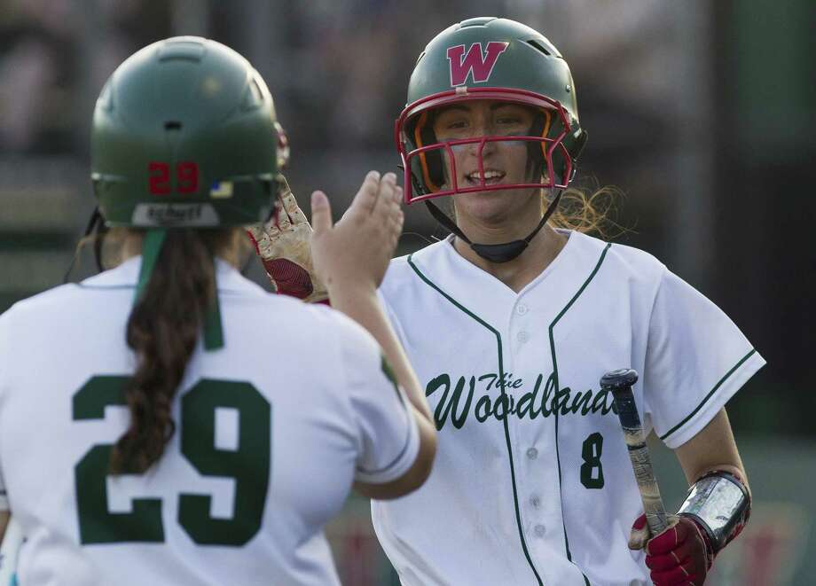 The Woodlands' Alayis Seneca gets a high-five from Lindsey Fischkelta after scoring on Abby Jones' RBI single during the first inning of Game 1 in a Region II-6A quarterfinal series on Thursday, May 10, 2018, in The Woodlands. The Woodlands defeated Rockwall 2-1. Photo: Jason Fochtman, Staff Photographer / Houston Chronicle / © 2018 Houston Chronicle