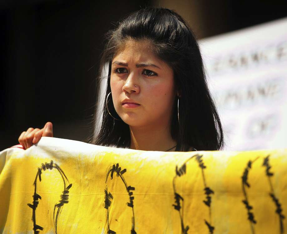 Yale student Larissa Martinez, 21, an undocumented immigrant from Mexico, holds a banner at an immigration rally outside the federal courthouse in Bridgeport on Wednesday. Photo: Brian A. Pounds / Associated Press / Connecticut Post