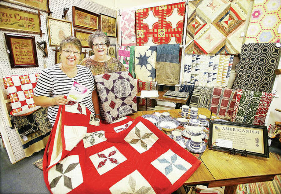 Longtime Alton businesswoman Ann Badasch, left, now has antiques space inside Country Meadows Antiques, 401 E. Broadway, in Alton. Badasch, seen here with Country Meadows owner Pam Voyles, right, said she will specialize in selling quilts. Photo:       John Badman|The Telegraph