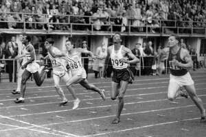 Lindy Remigino (981) wins the 100-meter final in the Olympic games at Helsinki, Finland, July 21, 1952, in the closest finish of the event in years. Jamaica's Herb McKenley (295) was second.  Remignio's time was 10.4 seconds.