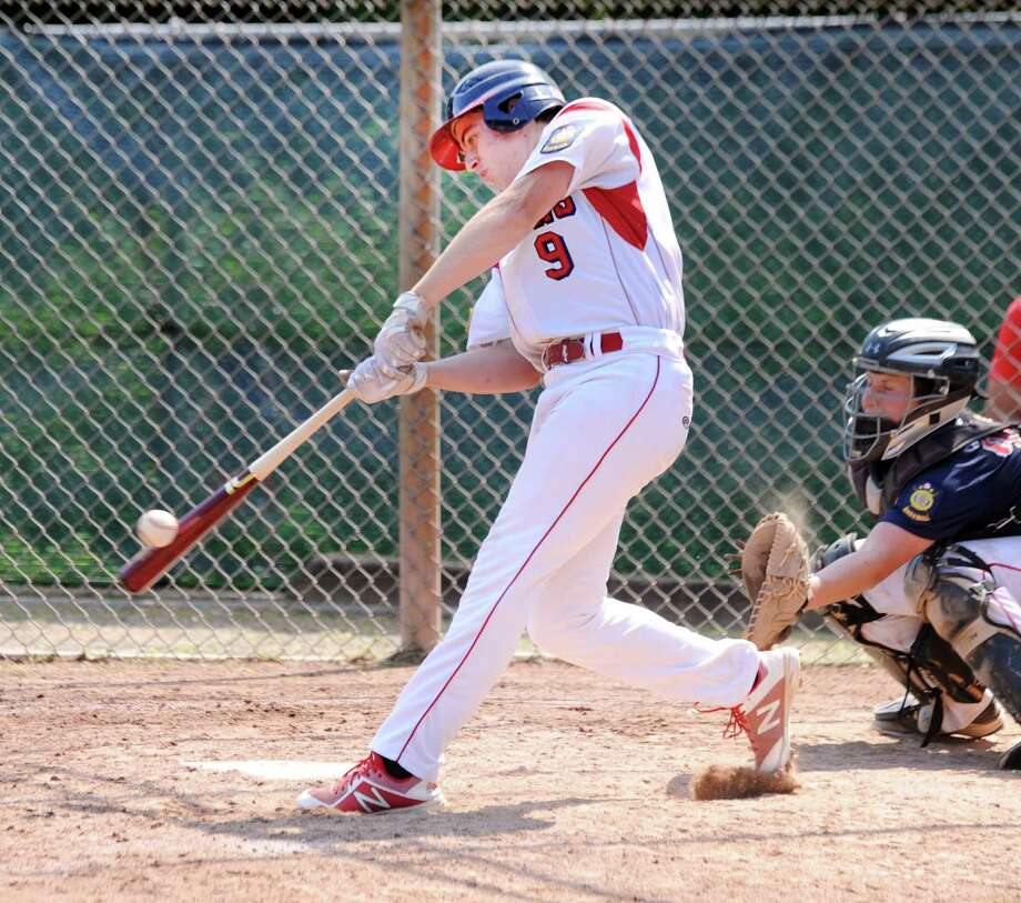 Harrison Feinberg of the Greenwich Red Cannons drives in two runs with a hit during the top of the third inning of the Junior American Legion baseball game between the Greenwich Red Cannons team against the Greenwich Blue Cannons team at Greenwich High School, Conn., Saturday, July 14, 2018. Photo: Bob Luckey Jr. / Hearst Connecticut Media / Greenwich Time