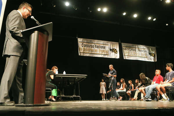 Defending champion Maria del Sol Nu–ez-Pe–a (at center podium), 14, an 8th grader at Chaparral Middle School in Chaparral, New Mexico, receives a word to spell  in the 2018 National Spanish Spelling Bee at the McAllister Fine Arts Center at San Antonio College on Saturday, July 14, 2018.  Nu–ez-Pe–a took first place once again in the event.  MARVIN PFEIFFER/mpfeiffer@express-news.net