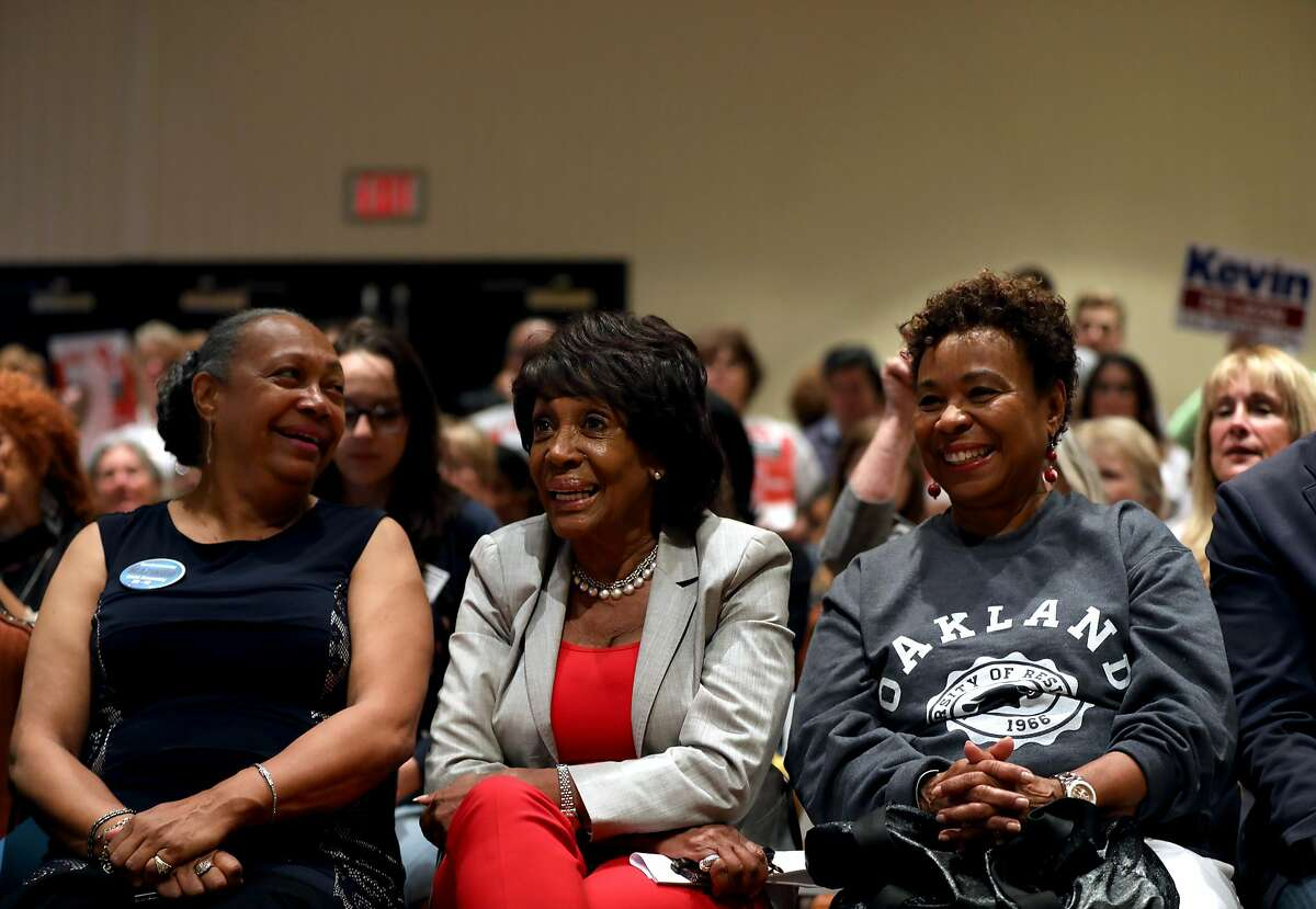 (From left to right) DeniAntionette Mazingo (cq'd), a candidate for Assembly District 42, U.S. Representative Maxine Waters (D-CA 43rd District) and Congresswoman Barbara Lee share a laugh during the 2018 Summer Executive Board Meeting, hosted by the California Democratic Party, at the Oakland Marriott City Center on Saturday, July 14, 2018, in Oakland, Cali.