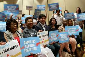"(From left to right) U.S. Representative Maxine Waters (D-CA 43rd District), Congresswoman Barbara Lee, State Sen. Kevin de Leon, and Susan Rubio, an educator running for state senate, raise ""Families Belong Together"" signs for a photo opportunity during the 2018 Summer Executive Board Meeting, hosted by the California Democratic Party, at the Oakland Marriott City Center on Saturday, July 14, 2018, in Oakland, Cali."