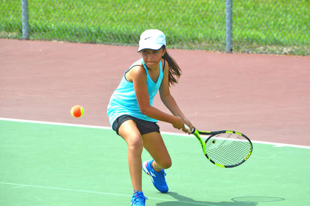 Kennedi Taylor, 10, of Edwardsville, competes in girls' 10 singles on Saturday at the Edwardsville Junior NET Tournament.