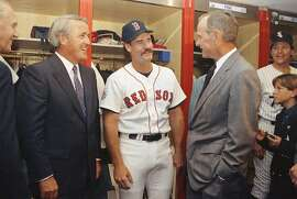 President George Bush, right, and Canadian Prime Minister Brian Mulroney, left, talk with Boston Red Sox Wade Boggs in the American League clubhouse before the start of the 62nd All-Star Game in Toronto SkyDome, Tuesday, July 9, 1991. (AP Photo/Dennis Cook)