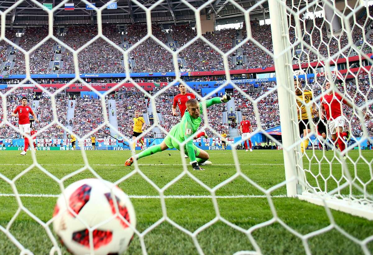 SAINT PETERSBURG, RUSSIA - JULY 14: Eden Hazard of Belgium scores Jordan Pickford of England his team's second goal during the 2018 FIFA World Cup Russia 3rd Place Playoff match between Belgium and England at Saint Petersburg Stadium on July 14, 2018 in Saint Petersburg, Russia. (Photo by Clive Rose/Getty Images)
