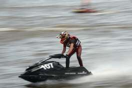"Haigen Smith, 15, maintains a lead to win in the second series of heats during ""Rumble on the River,"" a high-energy jet ski racing competition, hosted by The City of Orange and TX H20 Racing. Admission to the event is free, with concessions and childrens activities on site. The competition, which brings together racers from throughout the Southern region, continues Sunday, beginning at 10 a.m. at the City of Orange Boat Ramp. Saturday, July 14, 2018 Kim Brent/The Enterprise"