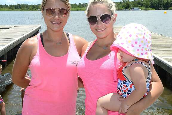"Shari Woolverton, Payton and Tayleann McDonald were at ""Rumble on the River,"" a high-energy jet ski racing competition, hosted by The City of Orange and TX H20 Racing. Admission to the event is free, with concessions and children's activities on site. The competition, which brings together racers from throughout the Southern region, continues Sunday, beginning at 10 a.m. at the City of Orange Boat Ramp.  Saturday, July 14, 2018  Kim Brent/The Enterprise"