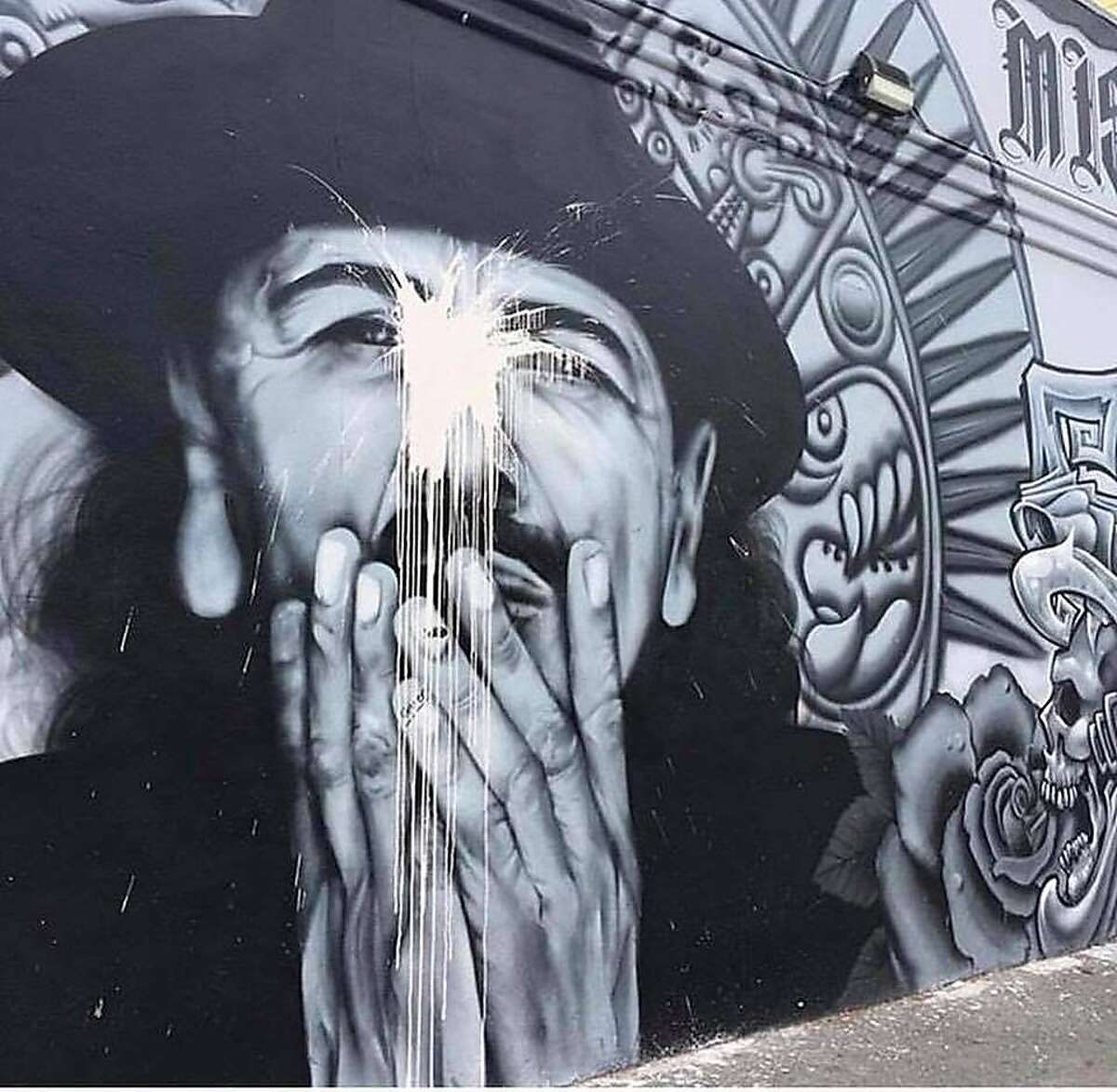A mural of Carlos Santana at 19th and Mission streets was vandalized on July 14, 2018 with what appeared to be white paint. The muralist later restored the mural.