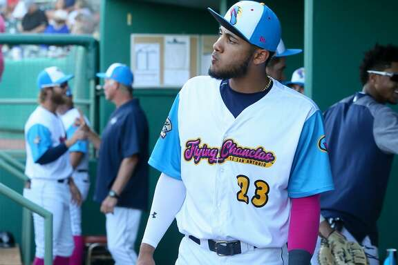 Fernando Tatis Jr. gets ready in the dugout for the start of the Flying Chanclas' game with Tulsa at Wolff Stadium on Thursday, May 24, 2018.  MARVIN PFEIFFER/mpfeiffer@express-news.net