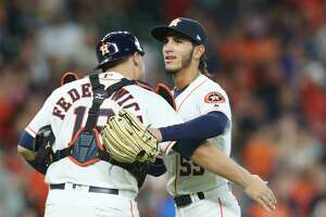 Houston Astros catcher Tim Federowicz (19) hugs Houston Astros relief pitcher Cionel Perez (59) after the last out against the Detroit Tigers at Minute Maid Park on Saturday, July 14, 2018. Astros won the game 9-1 and lead the Tigers 2-0 in the series.( Elizabeth Conley / Houston Chronicle )