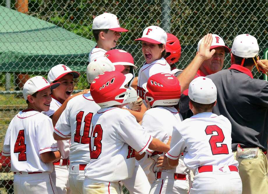 Fairfield American celebrates its win over Trumbull National in District 2 little league baseball action at Unity Park in Trumbull, Conn., on Saturday July 14, 2018. Photo: Christian Abraham / Hearst Connecticut Media / Connecticut Post
